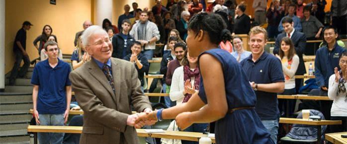 Professor Polenberg greeting a student